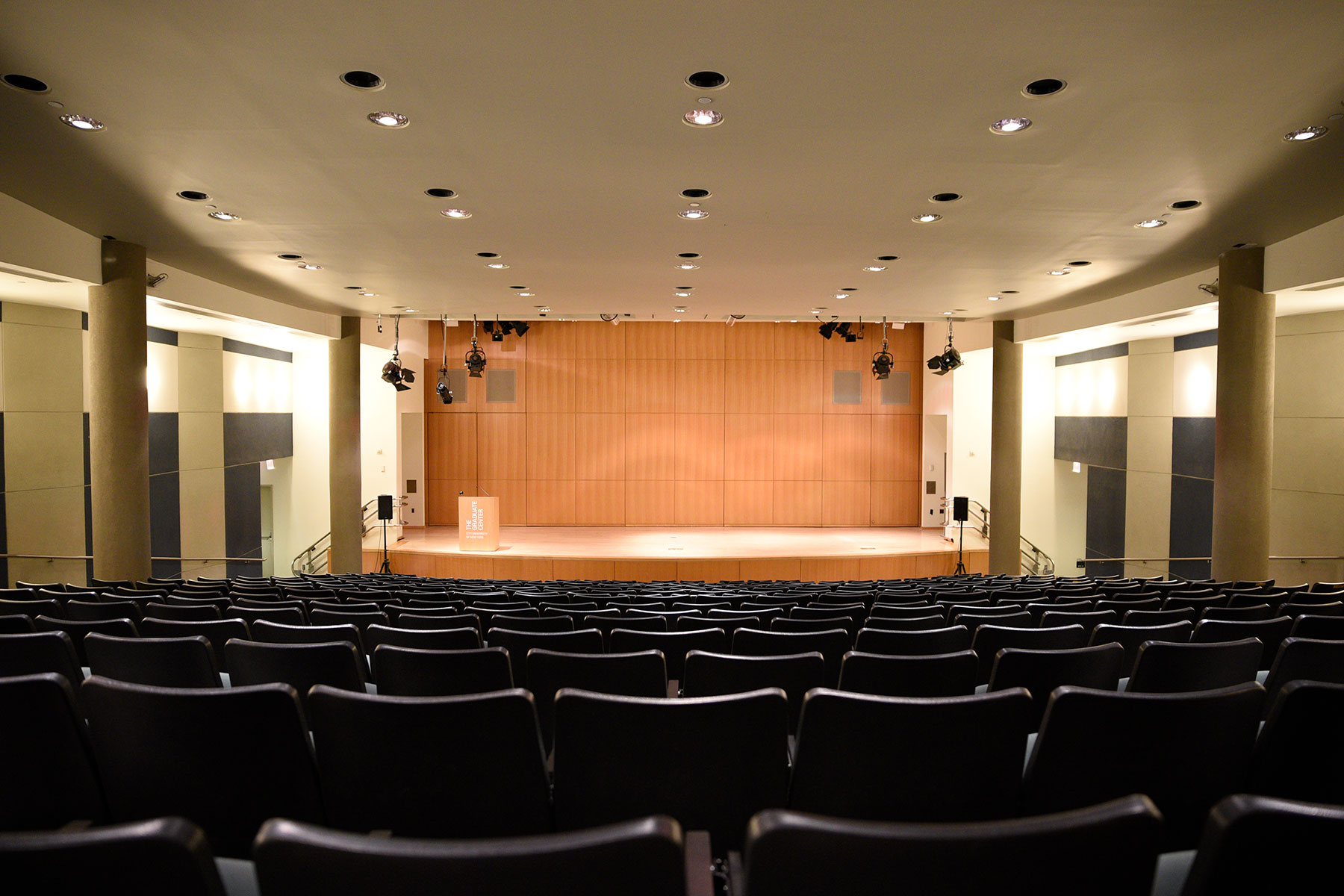 Proshansky Auditorium - Auditorium Rental in NYC. View from the back of the auditorium - stage and seating.