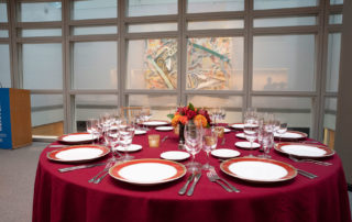 Kelly Skylight Room - Flexible Event Space in NYC. Table setting for corporate dinner, overlooking The Graduate Center's Dining Commons.