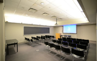 9th Floor Conference Room Suite - Meeting Space in NYC. Room set up for presentation.