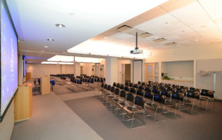 9th Floor Conference Room Suite - Meeting Space in NYC. Three adjoining rooms combined, set up theater style.
