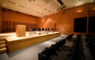 Elebash Recital Hall - Theater Rental in NYC. Front of auditorium - front row seating and stage.
