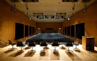 Elebash Recital Hall - Theater Rental in NYC. View from the back of the stage of the beautiful event space.