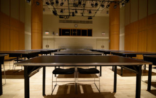Segal Theatre - Black Box Theater Rental in NYC. Set up classroom style, looking towards back of the theater space.